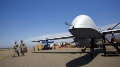 """A General Atomics MQ-9 Reaper stands on the runway during """"Black Dart"""", a live-fly, live fire demonstration of 55 unmanned aerial vehicles, or drones, at Naval Base Ventura County Sea Range, Point Mugu, near Oxnard, California July 31, 2015. REUTERS/Patri"""