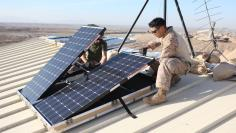 File photo of U.S. soldiers installing solar panels in Afghanistan