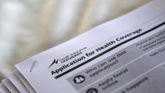 "The federal government forms for applying for health coverage are seen at a rally held by supporters of the Affordable Care Act, widely referred to as ""Obamacare"", outside the Jackson-Hinds Comprehensive Health Center in Jackson, Mississippi, U.S. on Octo"