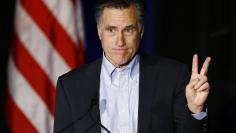 Former Republican presidential candidate Mitt Romney gestures as he speaks at the Republican National Committee Winter Meeting in San Diego, California January 16, 2015.  REUTERS/Mike Blake
