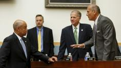 FILE PHOTO: U.S. Homeland Security Secretary Jeh Johnson (L) listens to Representative Tom Marino (R-PA) (R) before a House Judiciary committee hearing on the 'Oversight of the US Department of Homeland Security' on Capitol Hill in Washington July 14, 20