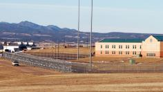 """FILE PHOTO --  Patrol vehicle is seen along the fencing at the Federal Correctional Complex, including the Administrative Maximum Penitentiary or """"Supermax"""" prison, in Florence, Colorado"""