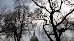 Clouds pass over the U.S. Capitol at the start of the third day of a shut down of the federal government in Washington