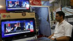 An Afghan man watches the TV broadcast of the U.S. President Donald Trump's speech, in Kabul, Afghanistan August 22, 2017. REUTERS/Omar Sobhani