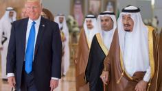 Saudi Arabia's King Salman bin Abdulaziz Al Saud walks with U.S. President Donald Trump during a reception ceremony in Riyadh