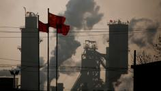 FILE PHOTO: Chinese national flags are flying near a steel factory in Wu'an, Hebei province, China, February 23, 2017.  REUTERS/Thomas Peter/File Photo