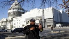 United States Capitol police officer Harry Dunn stops pedestrians in front of the U.S. Capitol in Washington March 29, 2016. REUTERS/Gary Cameron