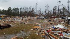 Debris covers an area of the Sunshine Acres neighborhood after a tornado struck Adel, Georgia