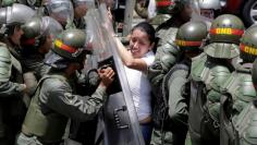 FILE PHOTO: Arellano, deputy of the Venezuelan coalition of opposition parties (MUD), clashes with national guards during a rally against Venezuela's President Nicolas Maduro's government in Caracas