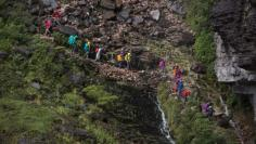 Tourists walk down from the top of Roraima Mount, near Venezuela's border with Brazil