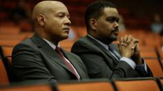 FILE PHOTO: Charlottesville Chief of Police Al Thomas (L) and Charlottesville City Manager Maurice Jones listen to speakers during a public forum hosted by the Department of Justice Community Relations Service after a rally by far-right demonstrators led