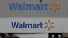 Shelves are stacked with merchandise at a Wal-Mart Stores Inc company distribution center in Bentonville, Arkansas June 6, 2013.     REUTERS/Rick Wilking