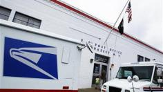 U.S. Postal Service loses $5.2 billion, warns of low cash
