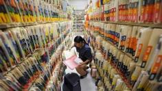 Service sector growth slips in October, hiring picks up