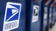 Postal Service loss narrows to $1.3 billion in October-December