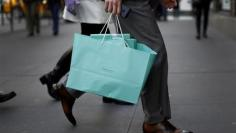 Consumer spending rises, driven by utility costs
