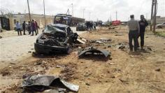 Car bombs kill at least eight at Libya army academy in Benghazi