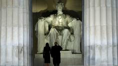 Trump salutes the statue of Abraham Lincoln as he and his wife take part in a Make America Great Again welcome concert in Washington