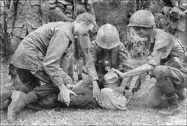 U.S. soldier in Vietnam supervises the waterboarding of a captured North Vietnamese soldier. Bettmann/Corbis